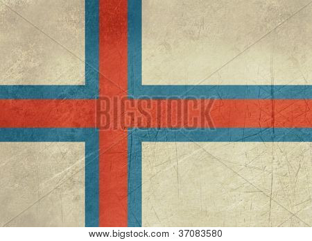 Grunge sovereign state flag of dependent country of Faroe Islands in official colors.
