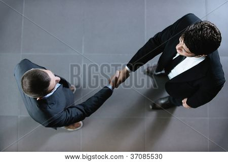 business people shaking hands make deal and sign contract