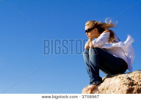 Pensive Sad Woman Sitting Alone