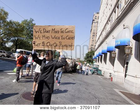 NEW YORK - SEPT 17: A protester holding a sign stands in front of a CitiBank branch near Bowling Green on the 1yr anniversary of the Occupy Wall St protests on September 17, 2012 in New York City, NY.
