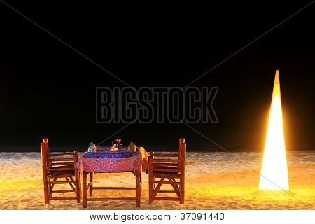 Dining table in the evening, a romantic dinner by the beach