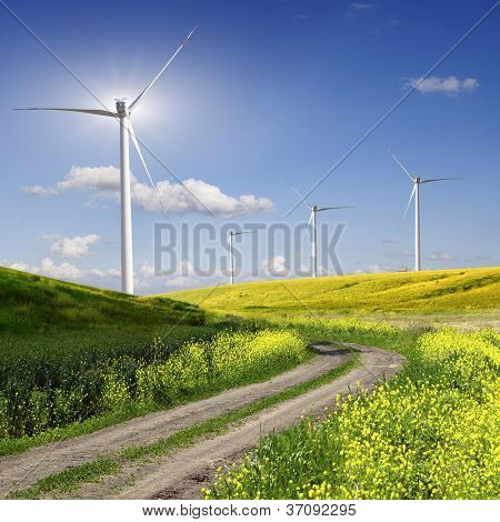 Rural road across the field to wind power