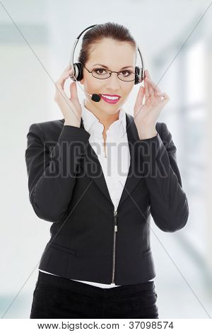 Portrait of a successful young female call center employee wearing a headset.