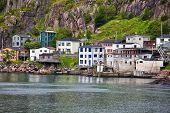Colorful houses on the rocky shore of Signal Hill facing the harbour in St. John's, Newfoundland, Ca