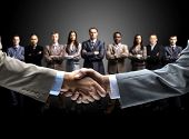 stock photo of promises  - handshake isolated on business background - JPG