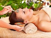 stock photo of beauty parlour  - Woman with clay facial mask in beauty spa - JPG