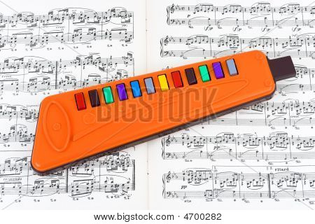 Toy Pipe And Sheet Music