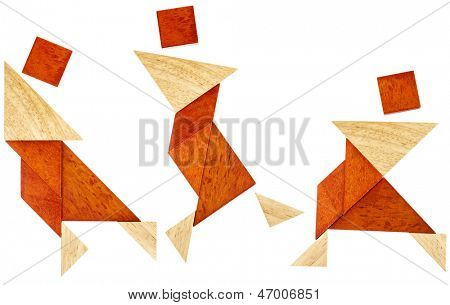 three abstract figures of a dancer or perhaps martial artist built from seven tangram wooden pieces, a traditional Chinese puzzle game