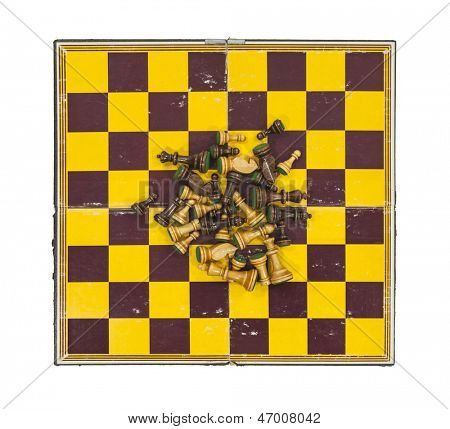 Vintage worn chess board with pieces in a pile.