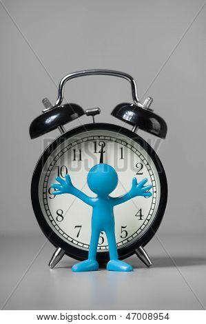 Blue man and an alarm clock.