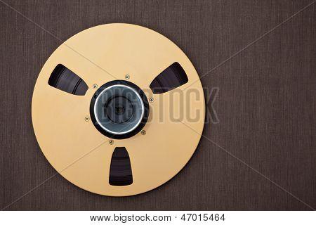 Professional audio metal reel on brown background