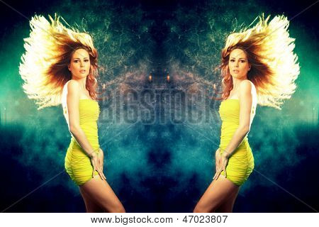 woman in short yellow dress and hair fly  dancing studio shot