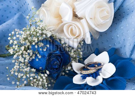 A  Blue Roses And Wedding Rings
