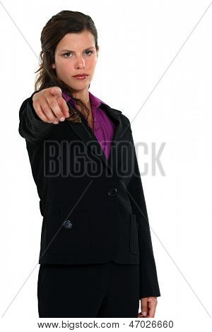 young businesswoman pointing at someone in front of her