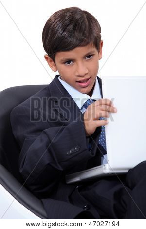 Child with suit and computer