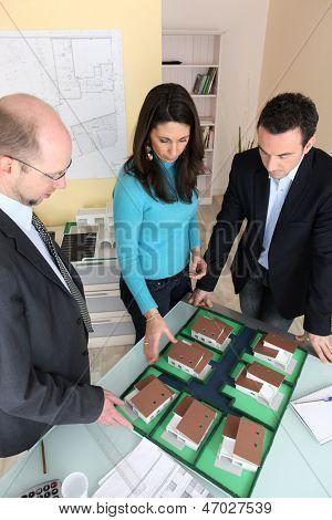 Architect with investors