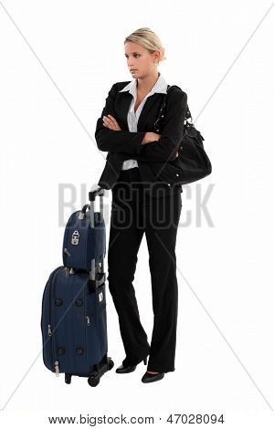Businesswoman with luggage waiting