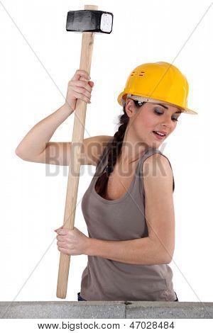 Tradeswoman using a mallet
