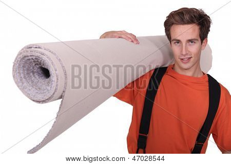 Man carrying a rolled-up carpet