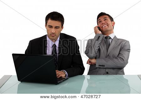 Businessman sitting next to colleague