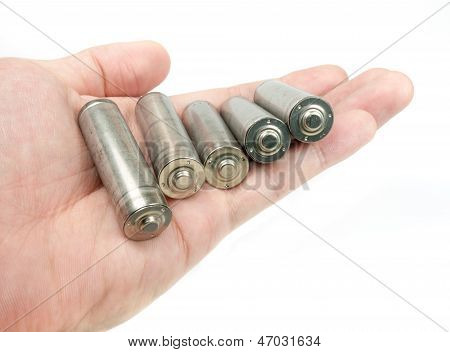 Hand Holding Set Of Unlabelled Aa Batteries