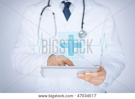 close up of male doctor holding tablet pc with medical app