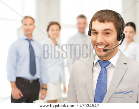 bright picture of friendly male helpline operator
