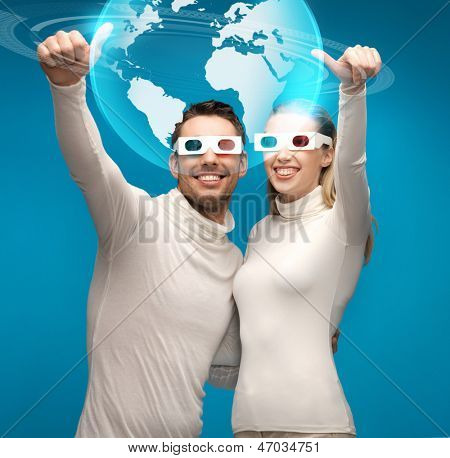 picture of woman and man in 3d glasses looking at globe model