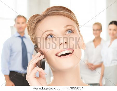 picture of businesswoman with cell phone calling