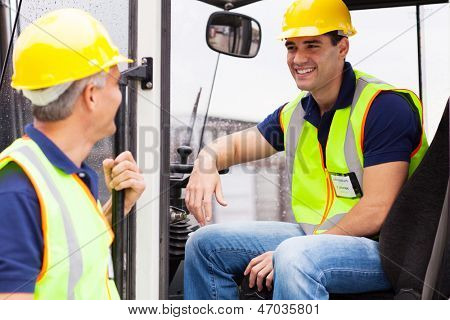 warehouse co-worker chatting during break on forklift