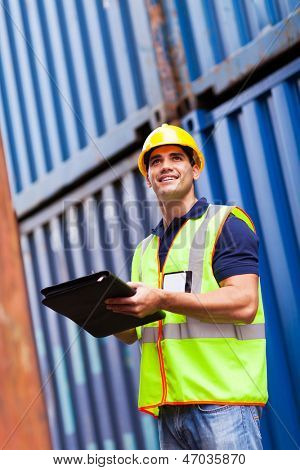 handsome young harbor container depot worker