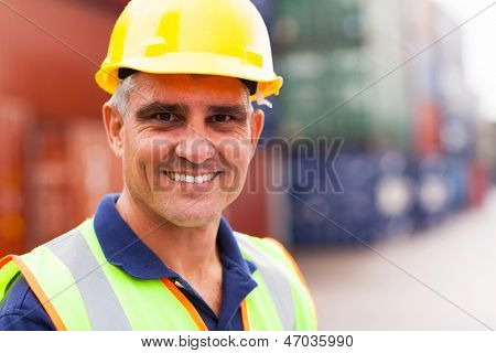 happy senior harbor worker at container depot
