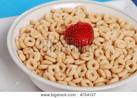 Closeup Bowl Of Cereal With Whole Strawberry