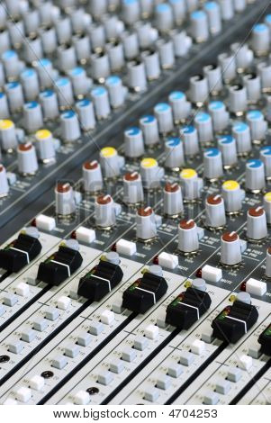 Sound Board Mixer With Focus On Black Sliders