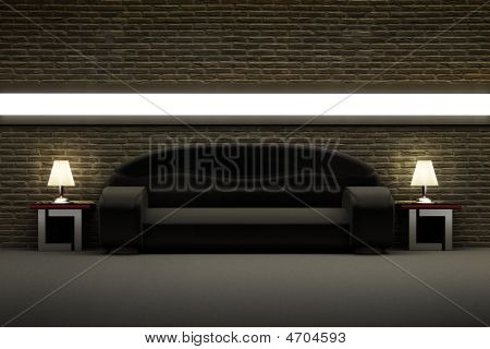 Black Sofa In The Room With Brick Wall