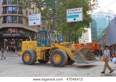 Excavator removing the barricades