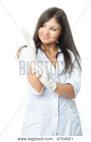 Doctor Putting On Sterile Rubber Gloves