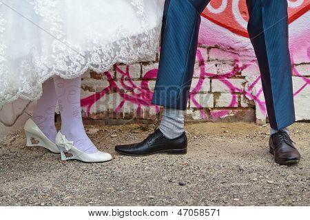 Legs of bride and groom
