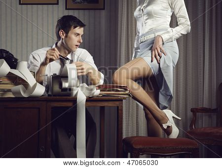 Young Sexy Woman Shows A Leg For Business Man