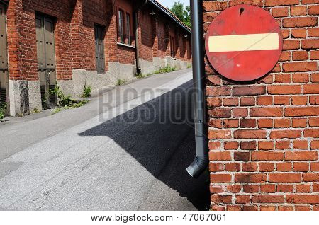No Entry Sign On A Brick Wall