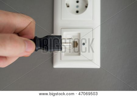Inserting Plug In Outlet