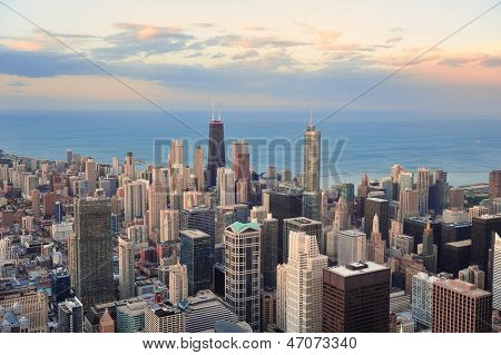 Chicago downtown aerial panorama view at sunset with skyscrapers and city skyline at Michigan lakefront with colorful cloud.