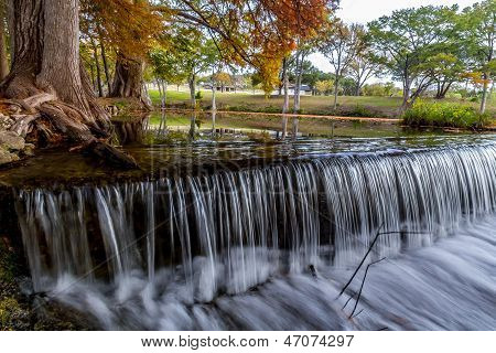 Silky Texas Hill Country Waterfall with Autumn Colors.