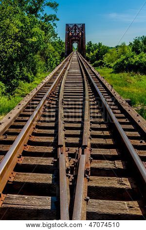 Converging Lines of Railroad Tracks on Old Trestle and Iron Truss Bridge.