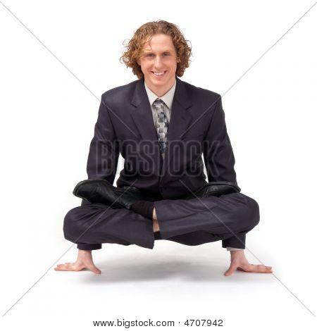 Businessman Sitting In Full Lotus Position.