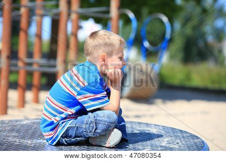 Thoughtful Child Boy Or Kid On Playground
