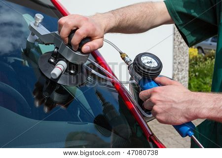 Glazier Repairing Windscreen After Stone Chipping Damage