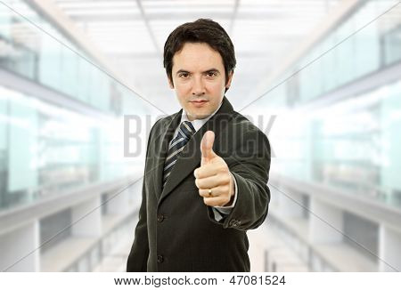 young business man going thumb up at the office