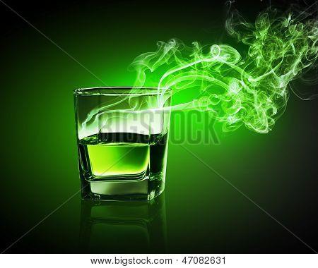 Glass of green absinth