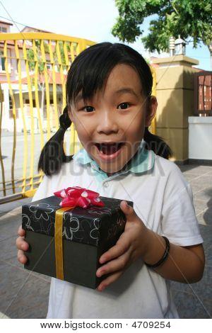 Girl Holding Present